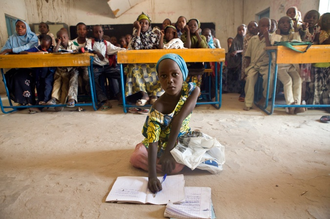 Students attend a maths class in Bosso, Nigeria. Thirty Nigerian refugees are studying at the school in addition to 300 Niger children.