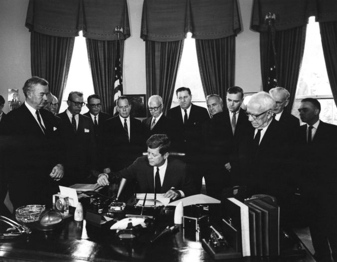 President John F Kennedy signing the Foreign Assistance Act