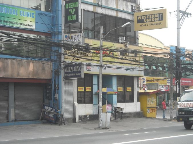 Western Union is one of the largest remittance services in the world.  Pictured here, an outlet in Angeles City, Philippines.