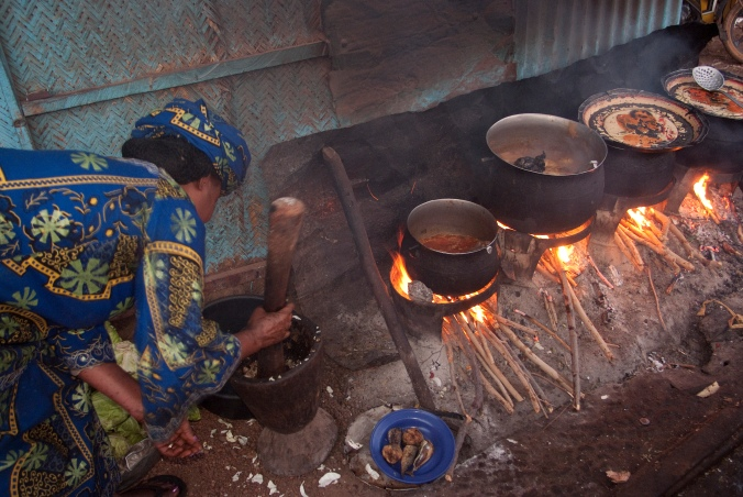 A woman uses fuel to cook in Burkina Faso. The WHO estimates that around 3 billion people globally still cook and heat their homes using solid fuels in open fires and leaky stoves. Image courtesy of Flickr user TREEAID under a Creative Commons Attribution 2.0 Generic License.